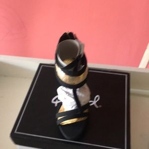 New black and gold heels